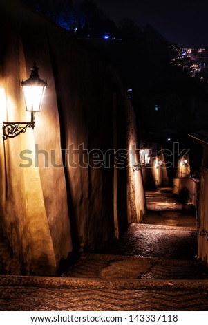 mysterious narrow staircase alley with lanterns in Prague at night - stock photo