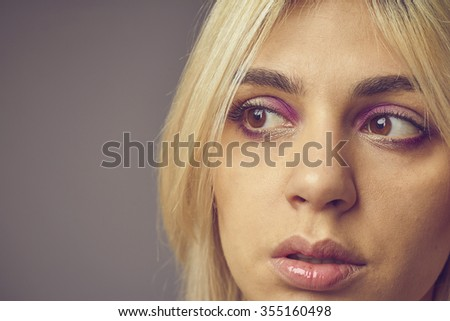 mysterious pensive business woman in a studio office portrait  - stock photo