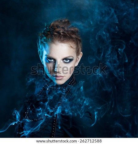 Mysterious portrait  beautiful females, red-haired girl in the smoke - stock photo