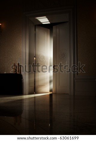 Mysterious rays of light behind door - stock photo