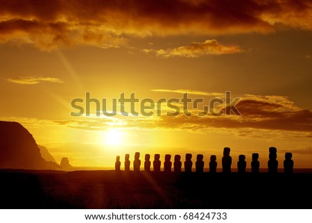Mysterious stone statues at sunrise in Easter Island - stock photo