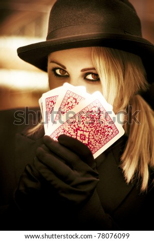 Mysterious Woman Gypsy Fortune Teller Holds Tarot Cards In A Psychic Reading Revealing Future Fortunes - stock photo