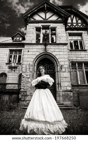 Mysterious woman in a white Victorian dress. The stylized photo at old - stock photo