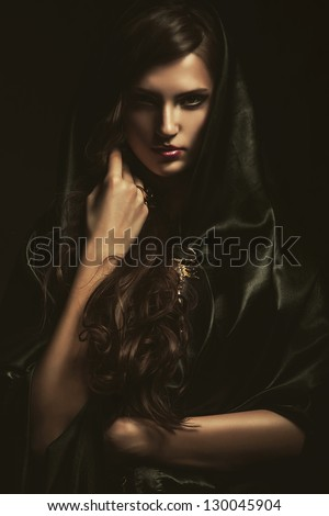 mysterious woman in black cape - stock photo