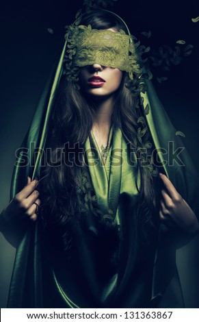 mysterious woman in green leaves bandage