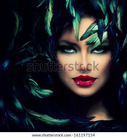 Mysterious Woman Portrait. Beautiful Model Woman Face Closeup. Feathers Hairstyle. Darkness.  - stock photo