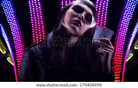 Mysterious woman us a colorfull background - stock photo
