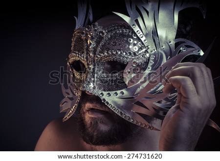 Mystery and Renaissance, adult man with mask silver and precious stones - stock photo