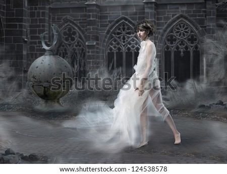 Mystery. Magic Woman Silhouette in Old Smoky Castle. Mystic Ancient Scenic - stock photo