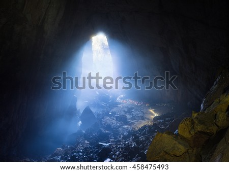 Mystery scene in Son Doong with blue mist, tents, rock, Son Doong Cave the largest cave in the world in UNESCO World Heritage Site Phong Nha-Ke Bang National Park, Quang Binh province, Vietnam