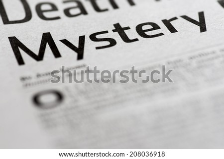 Mystery. Written mystery on real newspaper with shallow dof.