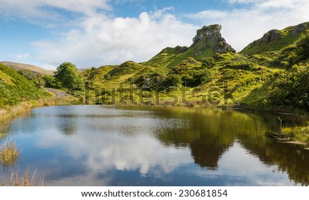 Mystic Fairy Glen, a romantic green valley with strange stone structures on the Isle of Skye, Scotland - stock photo