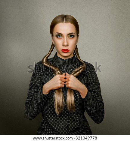Mystic girl with two plaits and red lips - stock photo