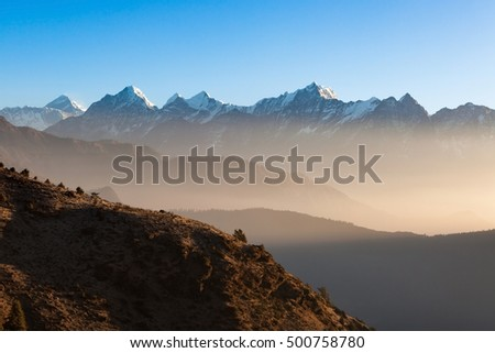 Mystic mountain sunrise scenery in Himalayas, Nepal. Stunning misty mountains scenery with high altitude peaks and Everest mountain on the background.