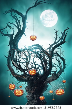 mystic tree with pumpkins on web at night