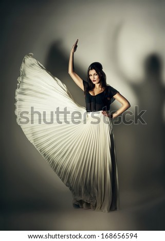 mystic woman with flying skirt - stock photo