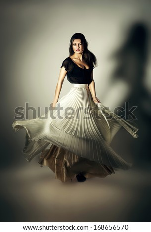 mystic woman with flying white skirt - stock photo