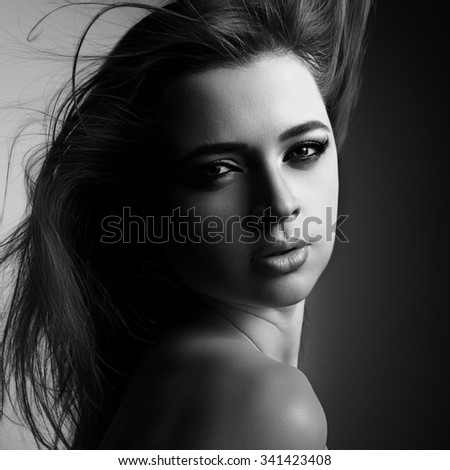 Mystic young woman with passion lips and smokey eyes looking sexy. Black and white portrait. Art - stock photo