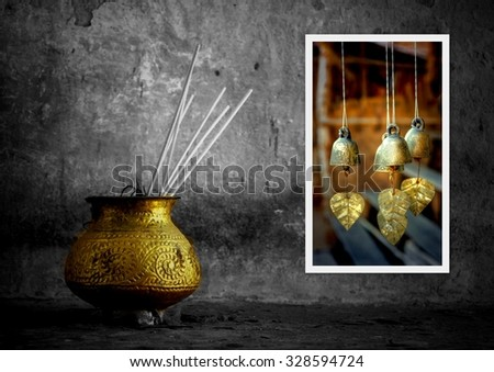 mystical background shows  with a bowl with incense and golden bells - stock photo
