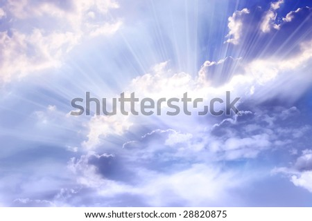 mystical blue sky with divine rays of light - stock photo