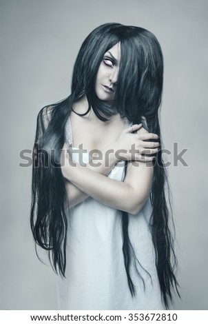 Mystical ghost beautiful woman portrait on gray background - stock photo