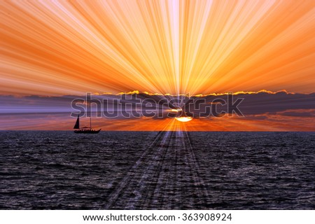 Mystical is a sailboat on a journey quest by sea with sun rays breaking through the clouds against a surreal sky. - stock photo