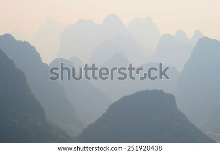 Mystical landscape of misty karst peaks - view from Moon hill in Yangshuo, China - stock photo