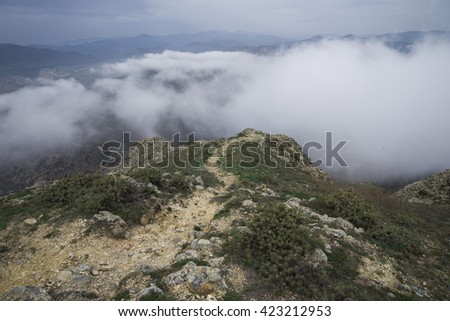 Mystical misty mountain landscape. Nasty cloudy weather