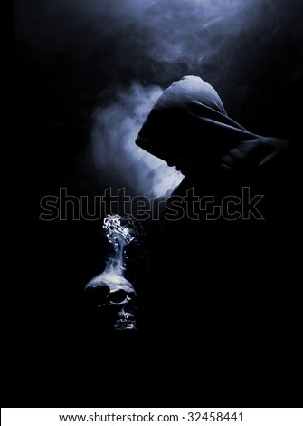 mystical monk with real cranium - stock photo