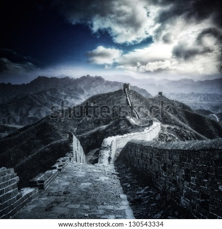 Mystical panorama on Great Wall of China - stock photo