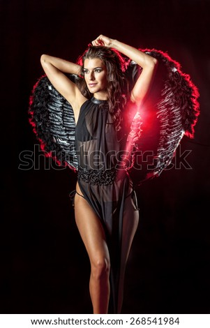 Mythical beauty. Dark angel with perfect hairstyle and makeup - stock photo