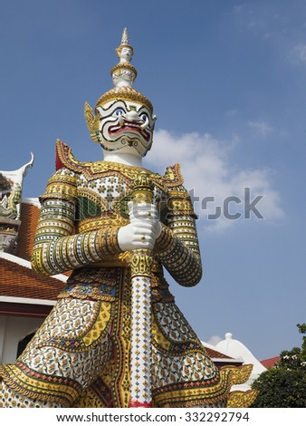 Mythical giant guarding the gate of Temple of the Emerald Buddha, Bangkok, Thailand - stock photo