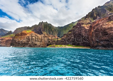 Na Pali coast's Honopu Beach and arch - stock photo