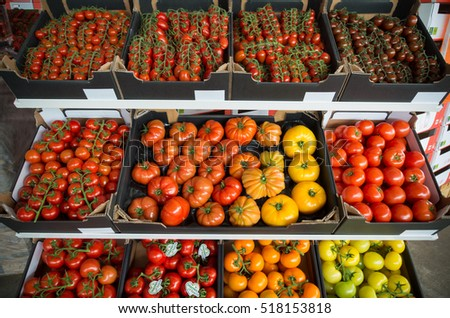 NAALDWIJK, NETHERLANDS - APRIL 2, 2016: boxes with different kind of ripe tomatoes in a dutch greenhouse