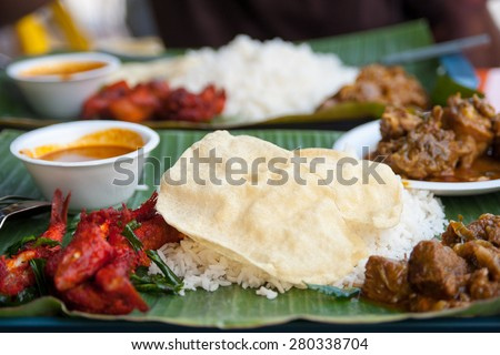 Naan ot chapati - the major food of indian tradition eating  - naan is flat bread over steamed rice on banana leaf plate eat with several type of curry - stock photo