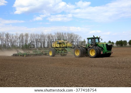 Naberezhnye Chelny, Russia - May 12, 2015: Planting in the field with the help of modern technology on a sunny spring day in May 2015