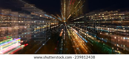 Naberezhnye Chelny, Russia - October 7, 2014: city night lights with the urban skyline and dramatic clouds in the night sky on the horizon  - stock photo