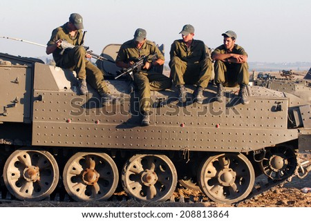 NACHAL OZ, ISR - JULY 06 2006:Israeli soldiers on armed vehicle .IDF is one of Israeli society's most prominent institutions, influencing the country's economy, culture and political scene. - stock photo