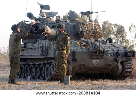 NACHAL OZ , ISR - JUNE 06 2006:Israeli artillery M109 howitzer unit.It's the most common Western indirect-fire support weapon of maneuver brigades of armored and mechanized infantry divisions. - stock photo