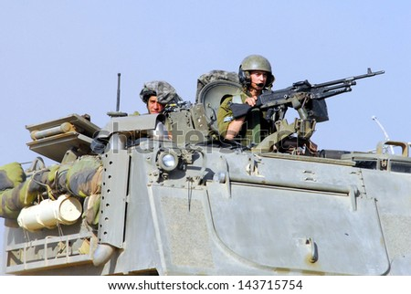 NACHAL OZ, ISR - JUNE 07:Israeli fighters on M113 armored personnel carrieron in North Gaza strip on June 07 2008.Under its disengagement plan in 2005,Israel retained exclusive control over Gaza strip
