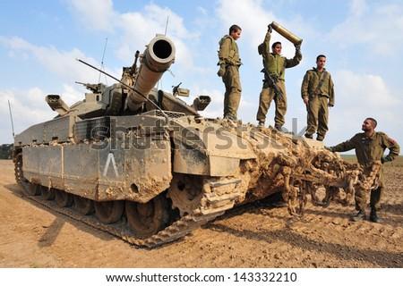 NACHAL OZ, ISR - NOV 12:Israeli soldiers on Merkava tank on NOV 12 2008.It's IDF battle tank designed for rapid repair of battle damage, survivability, cost-effectiveness and off-road performance. - stock photo
