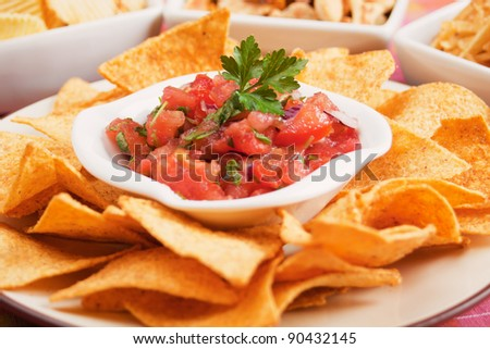 Nachos corn chips with fresh homemade mexican salsa - stock photo