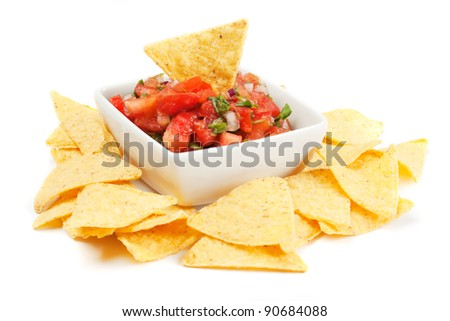 Nachos corn chips with fresh homemade salsa isolated on white - stock photo
