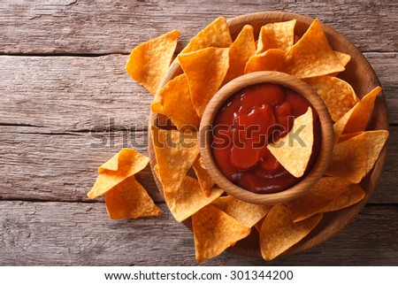 Nachos corn chips with sauce on the plate. horizontal view from above - stock photo