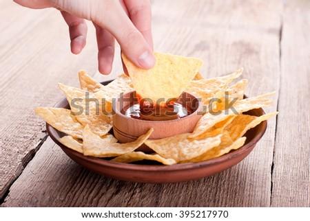 nachos in hand - stock photo