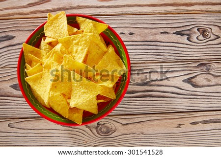 Nachos mexican food tortilla on red white wood background - stock photo