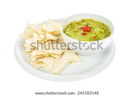 nachos on dish with guacamole isolated on white - stock photo