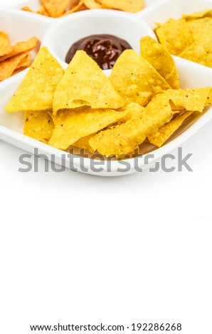 nachos served on a plate with dip - stock photo