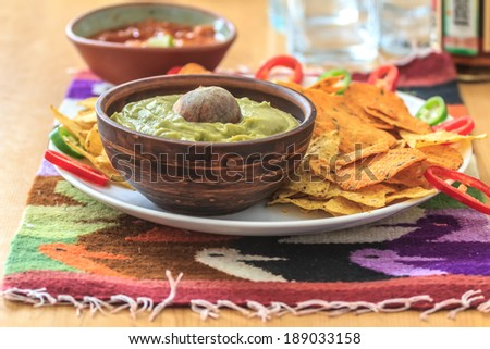 Nachos with homemade guacamole, red and green pepper and salsa