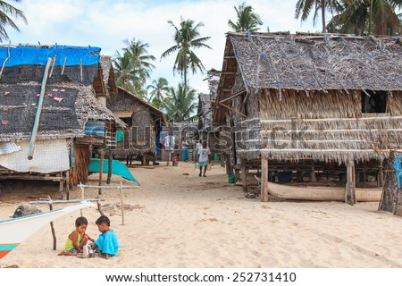 Nacpan, Philippines - January 17,2015: Local people in a Fishing village at Nacpan Beach, Palawan in the Philippines
